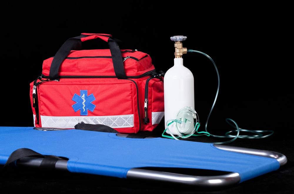 Medical equipment on isolated black background, horizontal